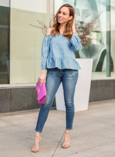 With cropped jeans, pink clutch and beige ankle strap high heels