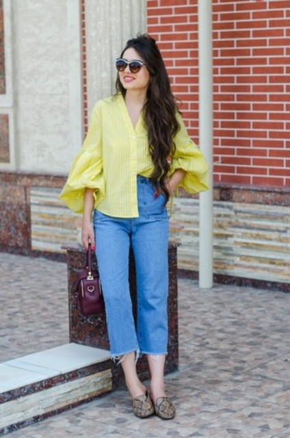 With cropped jeans, purple bag and snake printed shoes