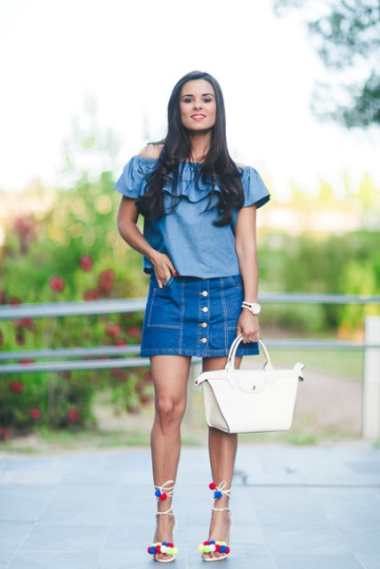 With denim button front skirt, white bag and lace up pom pom sandals