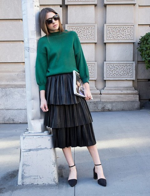 With emerald green sweater and black ankle strap shoes