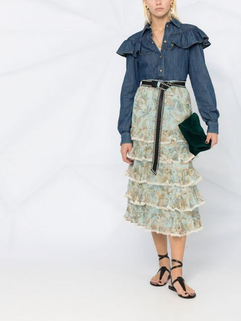 With floral printed tiered midi skirt, black belt, emerald velvet clutch and black lace up flat sandals