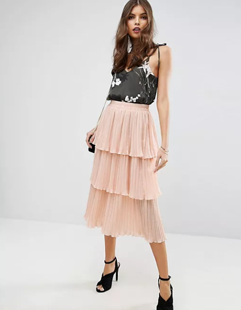 With floral printed top, chain strap bag and black shoes