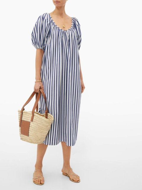 With golden flat sandals and beige and brown tote bag