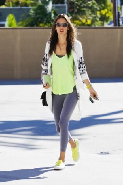 With gray leggings, green top, printed cardigan and black bag