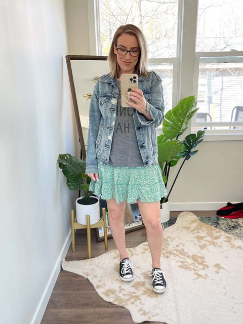 With gray t-shirt, denim jacket and black and white sneakers