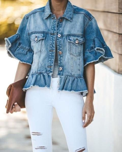 With gray t-shirt, white distressed pants and leather clutch