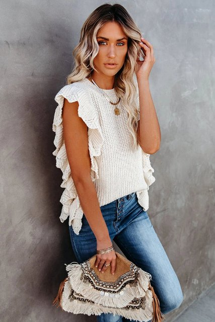 With jeans and fringe embellished clutch