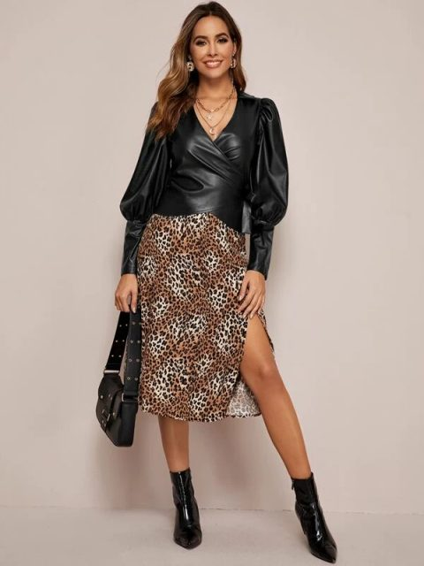 With leopard printed midi skirt, black patent leather boots and black leather bag