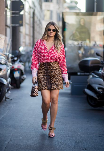 With leopard printed mini skirt, leopard printed bag and high heels