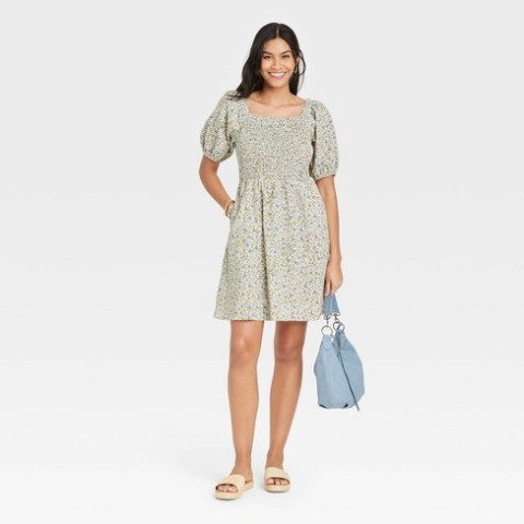 With light blue bag and beige flat sandals