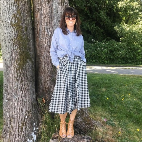 With light blue button down shirt and beige sandals