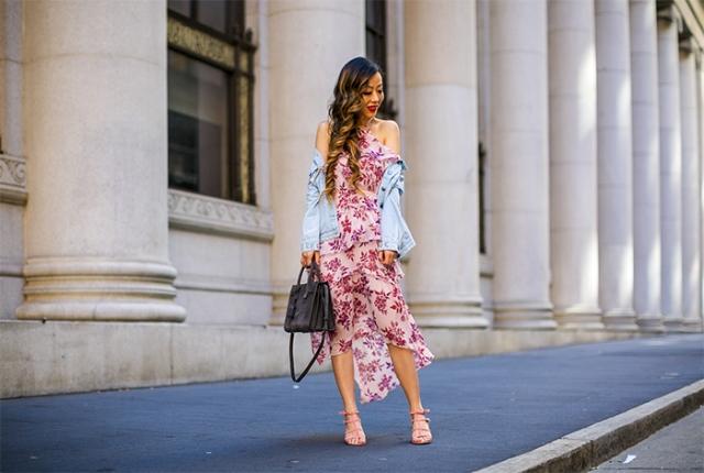 With light blue denim jacket, black bag and pale pink high heels