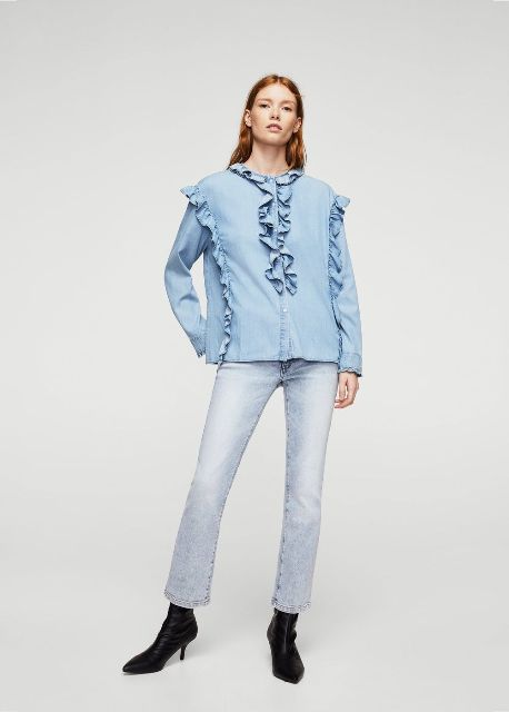 With light blue jeans and black low heeled boots