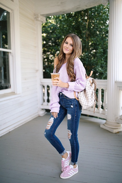 With lilac loose sweater, checked backpack and distressed skinny jeans