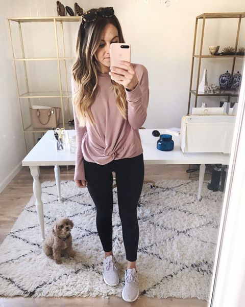 With pale pink loose shirt and black leggings