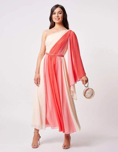 With pink belt, silver ankle strap shoes and rounded bag