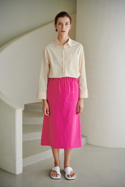 With pink midi skirt and white flat sandals