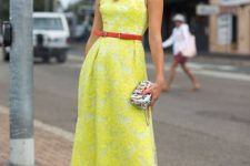 With printed clutch, sunglasses and polka dot pumps