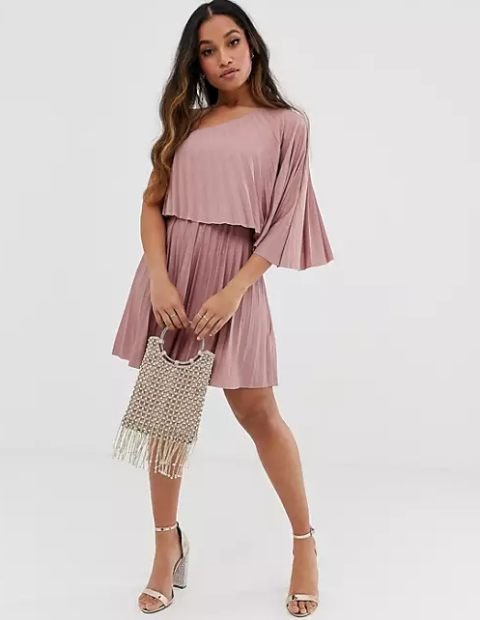 With sandals and fringe bag