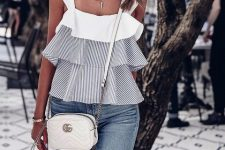 With skinny jeans and white crossbody bag