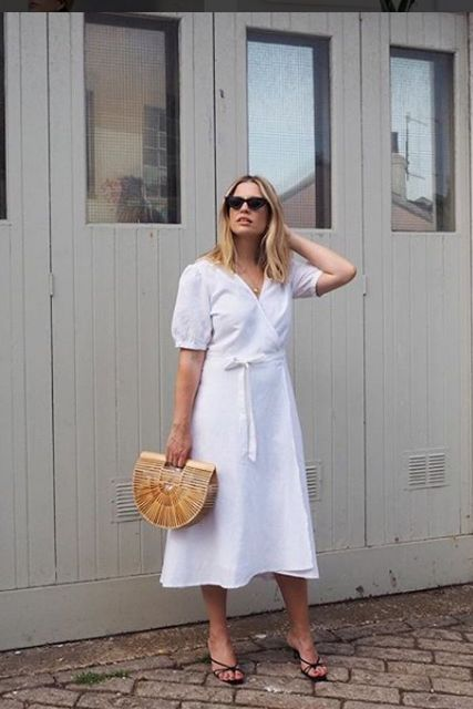 With straw bag and black sandals