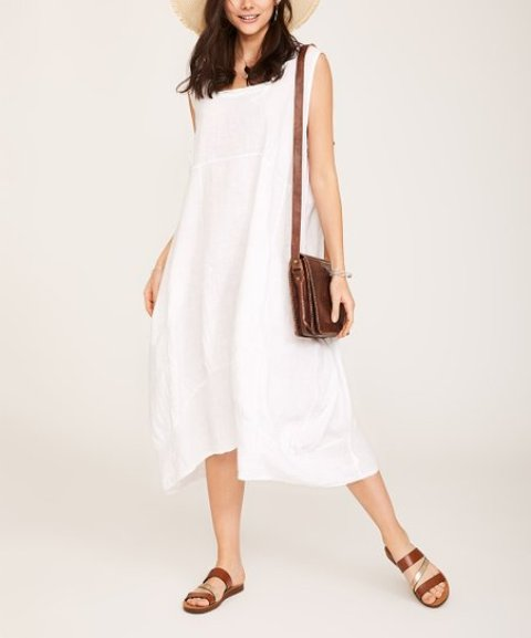With straw hat, brown leather bag and brown leather flat sandals