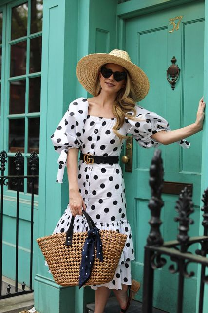 With straw hat, straw tote bag and black embellished belt