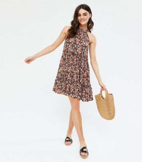 With straw tote bag and black flat sandals