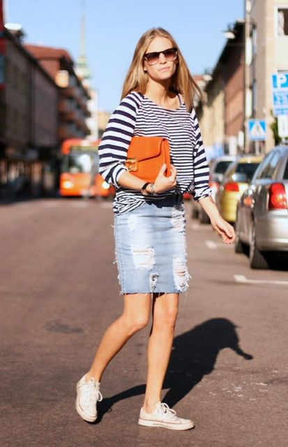 With striped loose shirt, orange clutch and sneakers