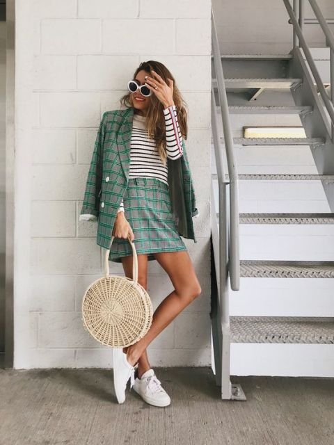 With striped shirt, straw rounded bag and white sneakers