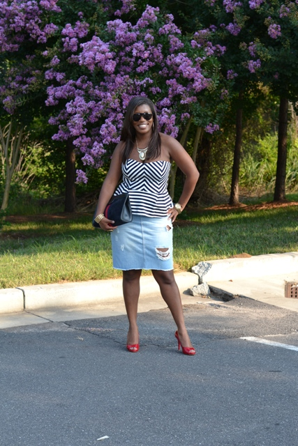 With striped top, black clutch and red shoes