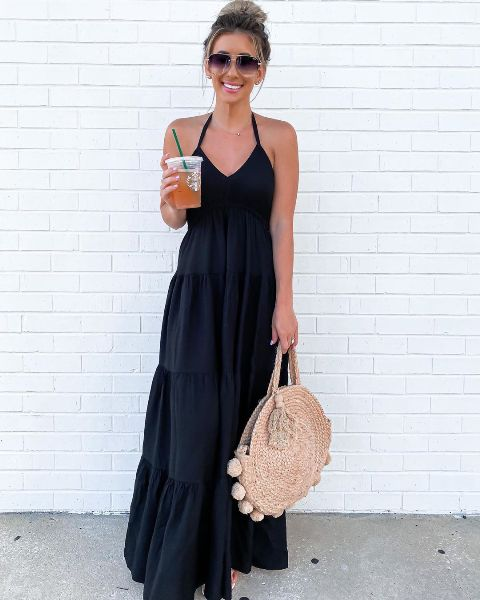 With sunglasses, beige rounded bag and sandals