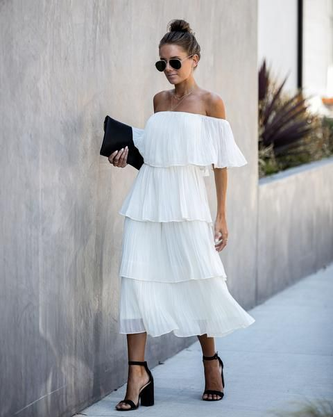 With sunglasses, black clutch and black high heels