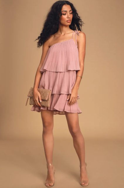 With transparent sandals and beige clutch