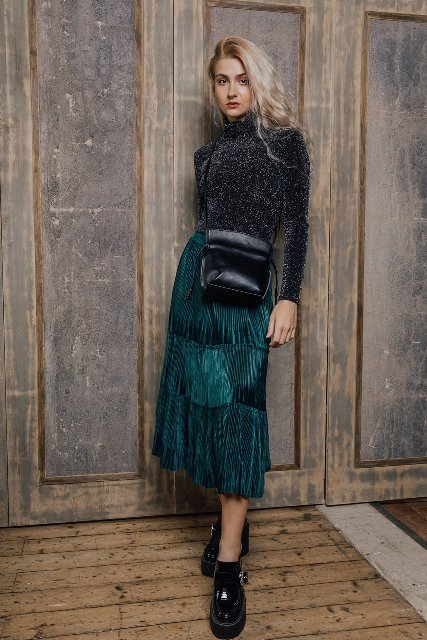 With turtleneck, black leather crossbody bag and black patent leather platform shoes