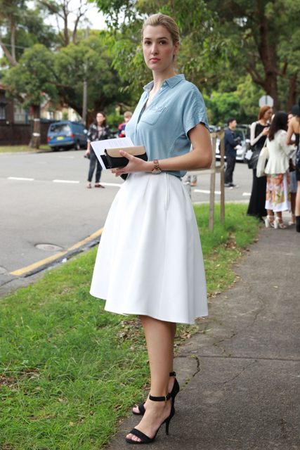 With white A-line midi skirt and black ankle strap sandals