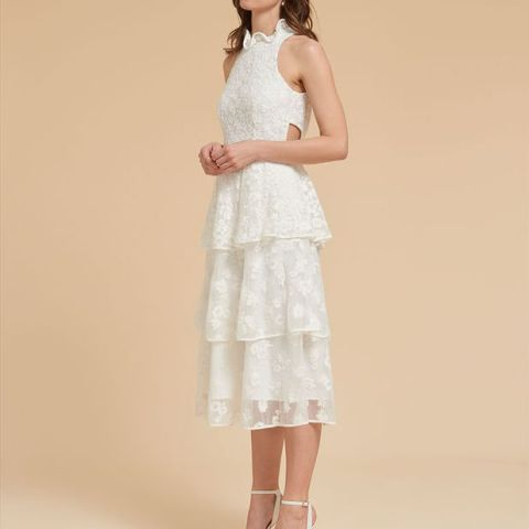 With white ankle strap shoes