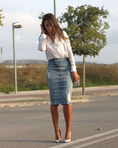 With white button down shirt, bag and silver pumps