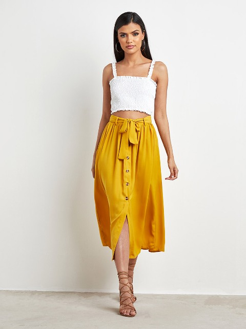 With white crop top and lace up sandals