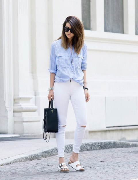 With white distressed pants, black bag and white flat sandals