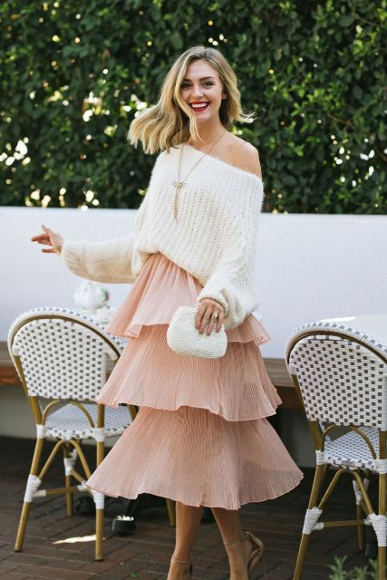 With white one shoulder sweater, white clutch and beige high heels
