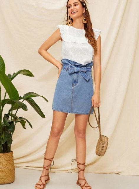 With white ruffled top, rounded bag and lace up sandals