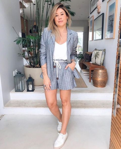 With white shirt and white flat shoes