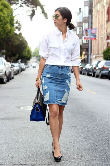 With white shirt, black and blue bag and black patent leather pumps
