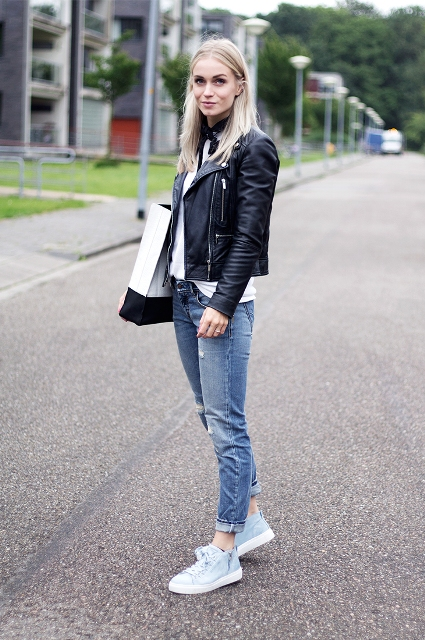 With white shirt, black cropped jacket, cuffed jeans and black and white tote bag