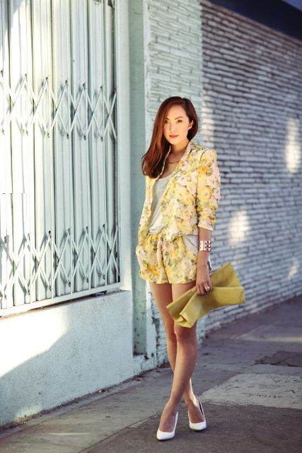 With white shirt, yellow clutch and white pumps