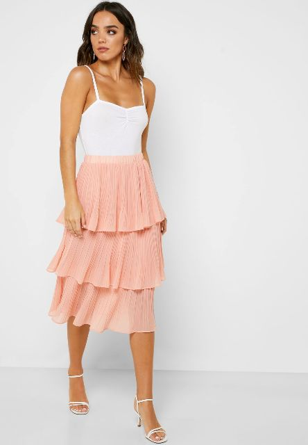 With white sleeveless top and white ankle strap shoes