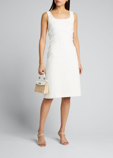 With white straw bag and white high heels