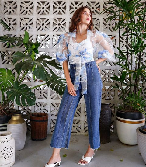 With white top, cropped jeans and white mules