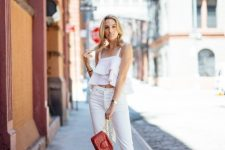 With white trousers, chain strap bag and gray ankle strap sandals